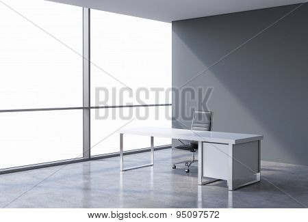A Workplace In A Modern Corner Panoramic Office, Copy Space On Windows. A Concept Of Financial Consu