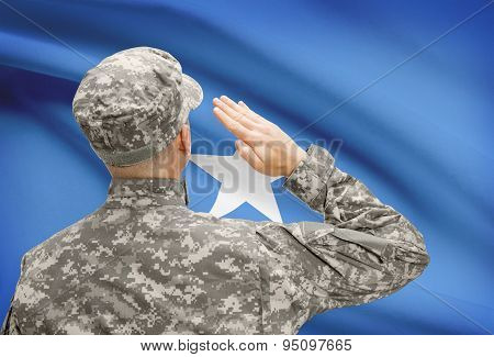 Soldier In Hat Facing National Flag Series - Somalia