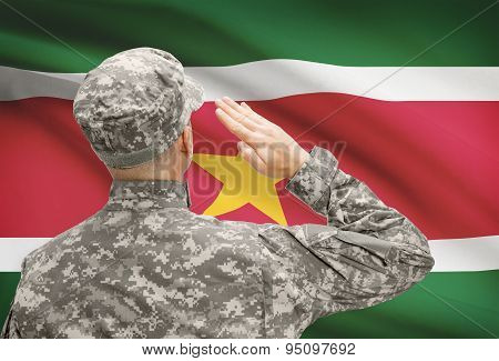 Soldier In Hat Facing National Flag Series - Suriname