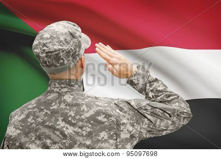 Soldier In Hat Facing National Flag Series - Sudan