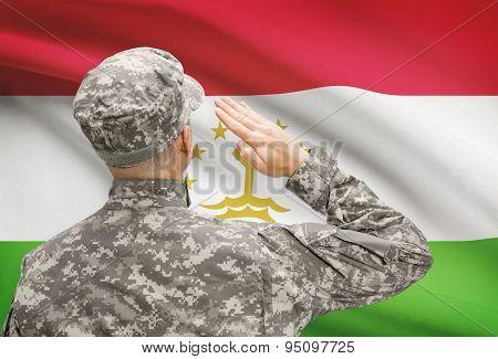 Soldier In Hat Facing National Flag Series - Tajikistan