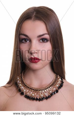 Closeup portrait of a beautiful girl with a black and gold necklace around her neck. Isolated over