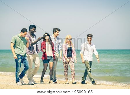 Group Of Happy Friends Walking A Talking At The Beach - Concept Of International Multiracial Friends