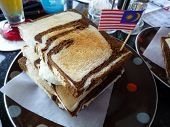 stock photo of malaysian food  - Close up of the toast brread with Malaysian flag - JPG