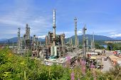 stock photo of inlet  - Oil refinery on a background of nature - JPG