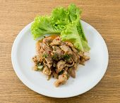 foto of thai cuisine  - Thai Cuisine and Food A Plate of Thai Traditional Nam Tok or Spicy Grilled Beef Salad Served with Lettuce Leaves - JPG