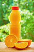 image of orange  - Bottle with orange juice - JPG