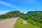 foto of dam  - asphalt road and blue sky on top of DAM - JPG