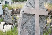 picture of stone sculpture  - Gray lava stone sculpture of a christian cross - JPG