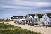 image of beach hut  - Beach huts on sand dunes and beach landscape - JPG