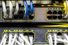 stock photo of telecommunications equipment  - Telecommunications Equipment in a metal rack. Network routers. ** Note: Soft Focus at 100%, best at smaller sizes - JPG
