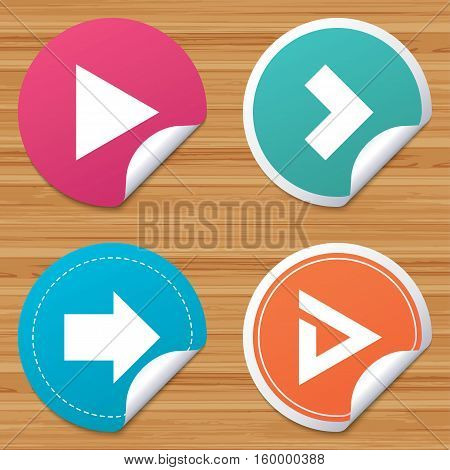 Round stickers or website banners. Arrow icons. Next navigation arrowhead signs. Direction symbols. Circle badges with bended corner. Vector