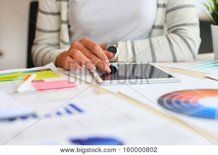 young businesswomen using digital tablet in the office