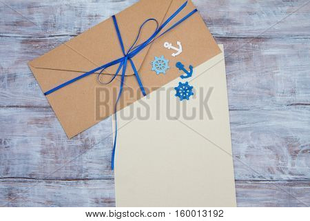 Kraft Envelope With Blue Ribbon And Blank Sheet Paper