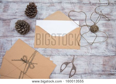 Kraft Envelopes, Blank Sheet Of Paper And Scissors