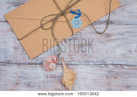 Kraft Envelope Tied With Twine And Decorations In Maritime Style