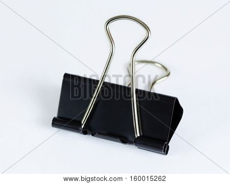 Black paper (binder) clip on white background