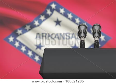 Pulpit And Two Microphones With Usa State Flag On Background - Arkansas