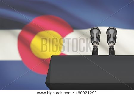 Pulpit And Two Microphones With Usa State Flag On Background - Colorado