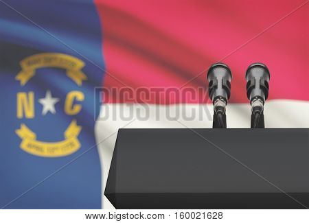 Pulpit And Two Microphones With Usa State Flag On Background - North Carolina