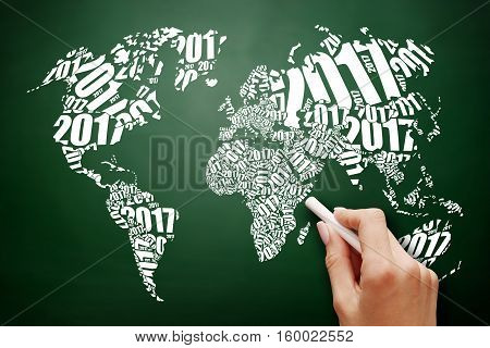 2017 Happy New Year World Map in Typography word cloud collage business concept on blackboard