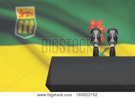 Pulpit And Two Microphones With Canadian Province Flag On Background - Saskatchewan