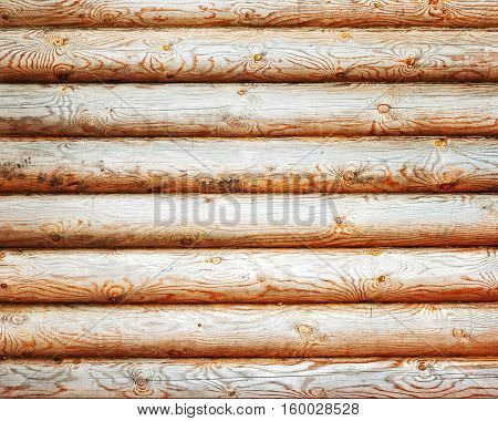 Natural background from log wall. Textures of wooden logs.
