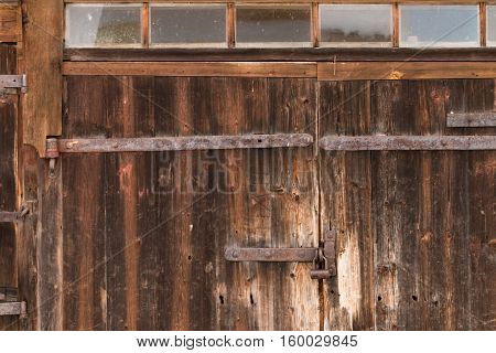 A view of a old wooden door. Vintage wooden gates