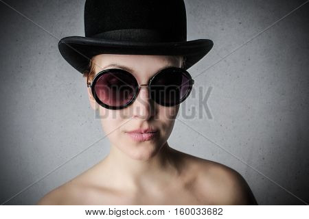 Girl in funny sunglasses and hat