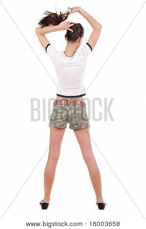 .beautiful junge Frau In Shorts, die Mauer zu betrachten. Ansicht von hinten.