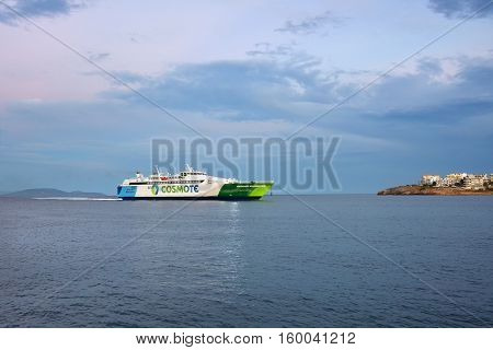 Rafina Greece - Sept 19 2016: View on the Cosmote Hellenic Highspeed ferry incoming the Rafina harbor at sunset time one from a many small port in Attica