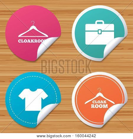 Round stickers or website banners. Cloakroom icons. Hanger wardrobe signs. T-shirt clothes and baggage symbols. Circle badges with bended corner. Vector