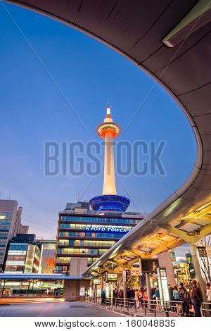 KYOTO, JAPAN - APRIL 7, 2014: Kyoto tower at night from Kyoto Station's bus terminal. The tower dates from 1963.