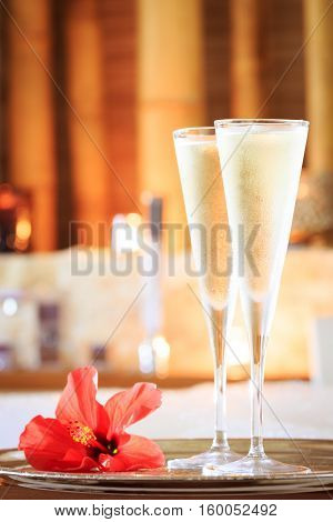 Two Glasses Of Champagne With Red Flower Near Jacuzzi. Valentines Background. Romance Concept