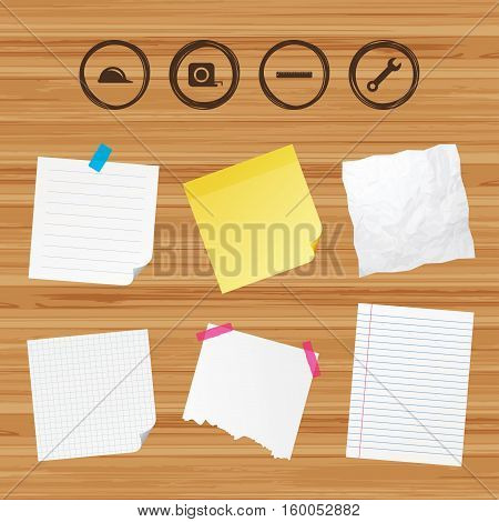 Business paper banners with notes. Construction helmet and wrench key tool icons. Ruler and tape measure roulette sign symbols. Sticky colorful tape. Vector