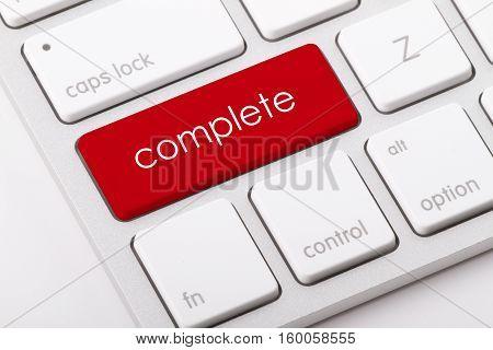 Complete word written on computer keyboard .