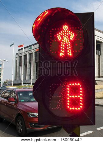 Traffic lights for pedestrians on a background traffic