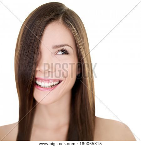 Hair care Asian woman smiling looking at white background copyspace. Beautiful girl with long straight brown hair for haircut or hairstyle beauty salon concept. Happy natural smile person.