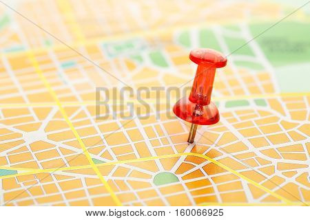 travel concept with red pushpin on map