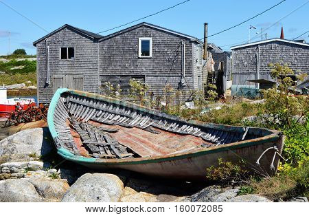 Old wooden boat on shore at Peggy's Cove in Nova Scotia