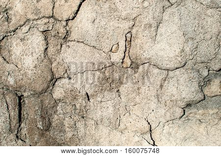 Texture of old gray stone wall covered with cement