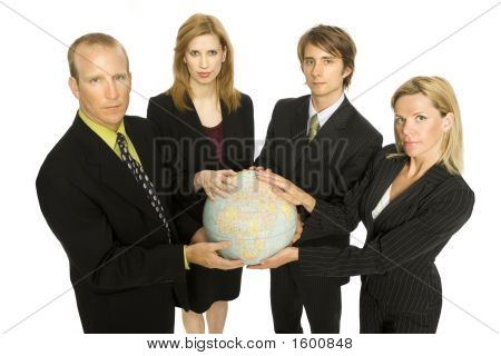 Four Business People Hold A Globe