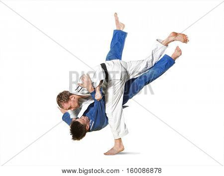 The two judokas fighters fighting men on white background
