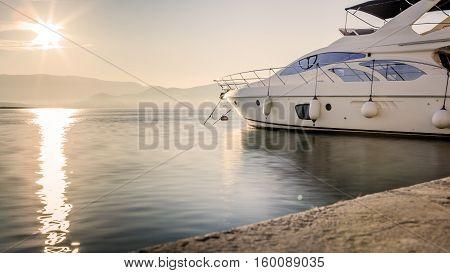Luxury Yacht at Harbor Before Sunset Long Exposure Shot