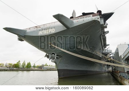 NEW YORK CITY - MAY 1 2016: Low angle view of the uss intrepid aircraft carrier in Manhattan. The ship is part of the Intrepid Sea Air & Space Museum and was build in 1943