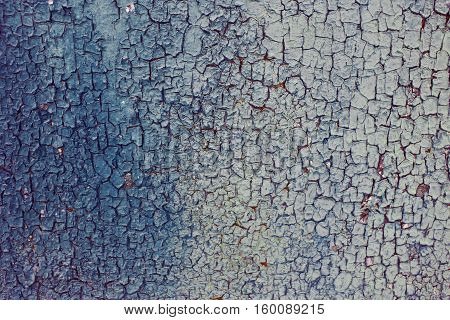 Blue rusty background rough rough texture in the cracks. Corrosion of metal iron. The Army the city banner billboard