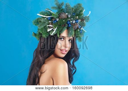 Winter Christmas Woman. Beautiful New Year And Christmas Tree Holiday Hairstyle And Make Up. Beauty