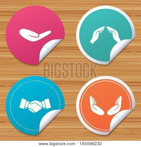 Round stickers or website banners. Hand icons. Handshake successful business symbol. Insurance protection sign. Human helping donation hand. Prayer meditation hands. Circle badges with bended corner