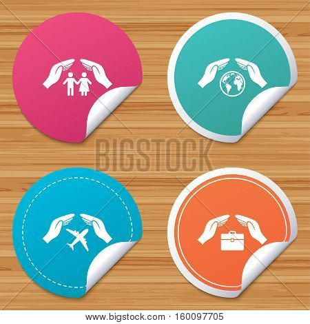 Round stickers or website banners. Hands insurance icons. Human life insurance symbols. Travel flight baggage symbol. World globe sign. Circle badges with bended corner. Vector