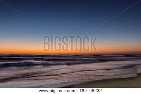 Night colors of the ocean beach and sky. Long exposure